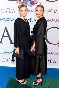 Olsens Anonymous Blog Mary Kate Ashley Olsen Twins Best All Black Looks CFDA Event Satin Silk Dresses Oversize Sleeve Sandals The Row Clutch Jewelry Earrings