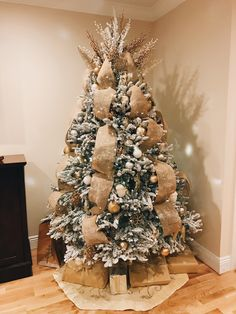 My 2017 Flocked Christmas tree with burlap ribbon. White, gold, silver, and rustic ornaments.