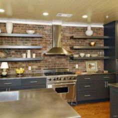 Beautifully-Organized Open Kitchen Shelving: If you view too many dishes out in the open as clutter in the kitchen, consider only displaying those that you use most often, keeping them on hand but clutter free. Kitchen Island With Stove, Open Kitchen, Kitchen Grey, Kitchen Pantry, Interior Design Kitchen, Home Design, Design Ideas, Diy Kitchen Shelves, Kitchen Cabinets