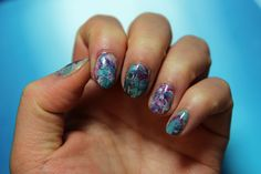 3/14/17 - Marbled nails using stamper inspired by pshiit / nailasaurus' tutorial. Polishes used: Essie's Sand Tropez, Essie's Garden Variety, Sinful Colors' Snow Me White, Julep's Rochelle, Essie's Licorice.