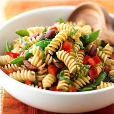Italian Pasta Salad - Low in fat and calories - this Italian-style dish makes a great healthy pasta salad alternative. Made with snap peas, sweet pepper, fresh basil, and olives, this side offers fresh flavors in every forkful.