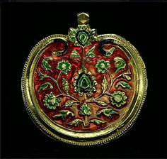 Mughal-Style Pendant from India. 20th Century. This pendant shows very clean, bright colors, and a boteh design in the middle. Size: 5cm across, 8mm thick. Weight: 31g.