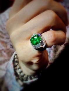 Gentleman's Emerald Pinky Ring in white gold setting with Trapezoid cut diamond shoulders framed by sparkling white brilliants. #emerald #gemstone #diamond #pinkyring #bling #green #perfectgift #highstyle #rake #geometric #tangsbychualee