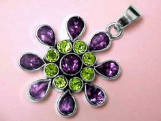 "Item: perj224  Pendant is 2.2"" long x 1.6"" wide (57mm x 41mm)  Price: $214.95  This extra large size sterling silver pendant is set with all natural gems of peridot and amethyst! This handcrafted pendant has eight 5mm round faceted peridot gemstones surrounding a 9mm round faceted amethyst gemstone at its center. This pendant was then set with eight 9x6mm pear shape amethyst gemstones around the outside. This beautiful amethyst with peridot jewelry design was hand crafted in sterling silver…"