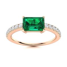 Lagina displays the perfect balance between a classical and contemporary design. Each diamond is meticulously placed and hand-crafted. Its gemstone is placed horizontally making it a remarkable Emerald engagement ring in 14k Rose Gold. Natural Emerald Rings, May Birthday, Afternoon Tea Parties, Love Ring, Shades Of Green, Vintage Rings, Ring Designs, Contemporary Design, Birthstones