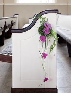 Aisle Dash: Aisle bloom made with a moss orb, phalaenopsis orchids and maidenhair fern, by Trapp and Company.