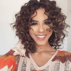 There are hundreds of languages around the world, but a smile speaks them all . @sheikhbeauty is smizing and slaying while flaunting her perfect curls ✨  #hairoftheday #NuMeStyle #curls