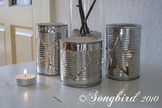 Tins turned into lanterns.  Re-purposing.