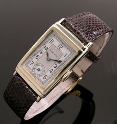 A gold rectangular stepped case vintage Rolex watch, 1937