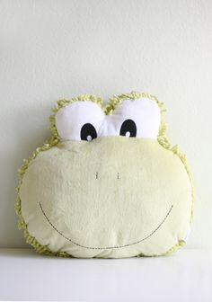 """Filbert The Frog Pillow 22.99 at shopruche.com. Incredibly soft, this plush green frog pillow will add a touch of charm to a child's room.17"""" x 15'"""