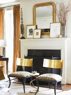 Living room fireplace, mantle | Chic living room with gorgeous gold klismos chairs upholstered in gray fabric, gold leaf mirror & frames, orange organza drapes and sisal rug | Source: courtneygiles.com | South Shore Decorating Blog: 50 Favorites For Friday (#115)