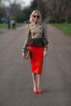 Lena Perminova styles bold red with subdued tan for a lesson in contrasts. #pop #color #brown