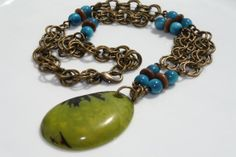 Lime Green and Brown Tagua Nut Pendant with Antique Brass Rings and ...