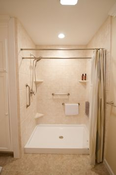 Doorless walk in shower - dual shower rods - shower shelving - low threshold walk in shower - multiple grab bar shower - Bathroom Remodel - Brought to you by Re-Bath of the Triangle