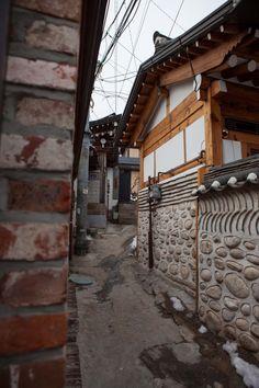 Cute alleyways of Bukchon Hanok Village in the winter.