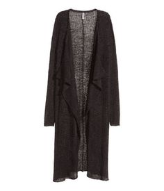 Long, loose-knit cardigan with draped panels at front and no buttons.