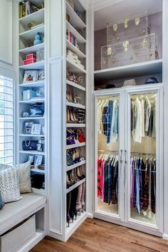 Walk-in+closet+boasts+a+built-in+window+seat+flanked+by+floor+to+ceiling+shoe+shelves.