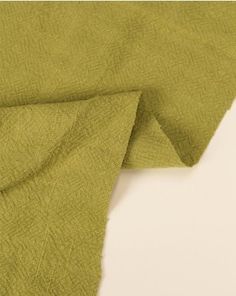 Stonewashed linen fabric in light pesto green. This natural fabric has a subtly textured weave, creating a heavier weight perfect for summer trousers, dungarees and jackets Dungarees, Linen Fabric, Pesto, Weave, Trousers, Pure Products, Natural, Green, Summer