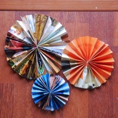 Recycle magazine pages by turning them into paper rosettes!  Saw this recently, and they look great.  :)