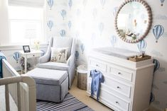 Such a sweet nursery! We love the hot air balloon wallpaper!