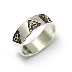 Silver and Gold Celtic Knot band. The band has 3 gold Celtic Trinity knots in ( More can be added as a custom order) This one is a size Z (can be adjusted ) Ring is wide Irish Wedding Rings, Celtic Wedding Bands, Handmade Wedding Rings, Gold Wedding Rings, Handmade Jewelry, Celtic Rings, Celtic Knots, Celtic Trinity Knot, Silver Jewelry
