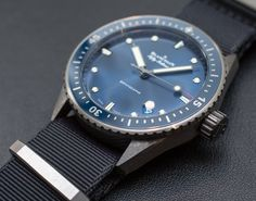 Hands-on review & original photos of the Blancpain Fifty Fathoms Bathyscaphe watch in blue & ceramic with price, specs, & analysis.