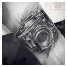 Black And White Camera Tattoo On Wrist beautiful--- would love to add some film ribbon and a book