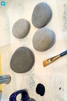 Everyone can't stop pinning this idea!A pretty surprise for your garden or potted plants. Make with smooth river stones and liquid chalk markers! Sponsored post.