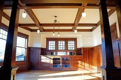 Dining room with built-in china cabinet, ceiling beams and wainscoting - 1910 Craftsman house, Portland, OR
