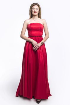 Elegant Floor Length, Solid Color Prom and Evening Gown has Strapless Bodice with Low Back, Zipper Side Closure and Gemstones Embellished Waistline, Flowing A-Line Skirt with Sweeping Train Completes the Style.