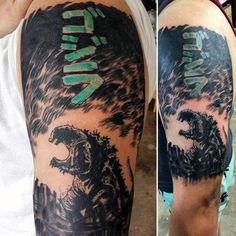 Black Tattoo With Color Godzilla Japanese Script On Mans Bicep