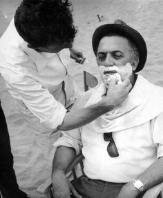 Federico Fellini getting a shave on the set of Juliet of the Spirits