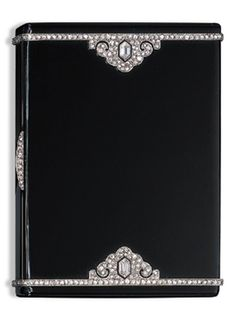 AN ART DECO BLACK ENAMEL AND DIAMOND CIGARETTE CASE, BY CARTIER. Of rectangular outline, the black enamel case with diamond-set trim and palmette detail, circa 1929, with English assay marks.