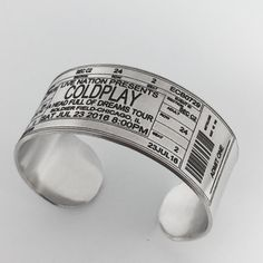 Turn your concert, movie, play ticket into a wearable memento! This cuff bracelet is made in a simple and versatile unisex style. The bracelet is created individually by hand, engraved, and polished to a shiny silver finish. >> DETAILS << - 6 long and 1 wide = One Size Fits Most - Adjustable - Metal can be gently molded to fit your wrist. - Durable - permanent engraving wont rub or wear off Your Choice of : Aluminum or NuGold Aluminum = Lightweight, Hypoallergenic & Tarnish Resistant N...