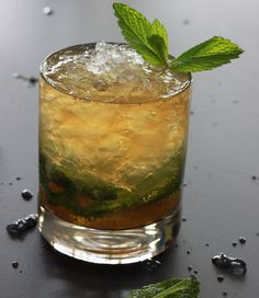 Alton Brown's Mint Julep Recipe: A great summer sipper, not just for Derby Day. I prefer an old-fashioned glass to the traditional metal julep cup because glass insulates rather than conducts heat keeping my cocktail cool. Crushed ice makes a difference here. This is the way my parents did it back in the 1960s.