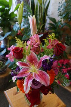 A beautiful arrangement of stargazer lilies, red roses, gerber daisies, solidago, and other fresh flowers in a clear glass vase with bow.  Joy Flower Shop is the premier online florist for the cities of Carmichael and Sacramento and their surrounding areas. Order flowers from Joy Flower Shop and get same day local flower delivery from our shop located in Carmichael. We deliver to the cities of Carmichael, Sacramento, Rancho Cordova, Gold River, Fair Oaks, and Citrus Heights.