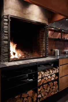Kadeau (Copenhagen, Denmark), OEO Studio. large open cooking fire in kitchen