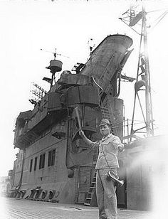 IJN semaphore / aircraft director onboard an unidentified carrier. Note the wood plank runway