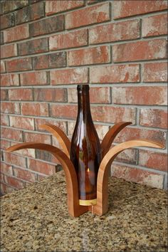 We handcraft each of our wooden candleholders ourselves in our workshop using a variety of hardwoods. This wooden wine bottle candleholder is crafted with gorgeous African Mahogany and Yellowheart hardwoods. Then sealed with a crystal-clear gloss lacquer finish. The globe is a repurposed 750 ml wine bottle.