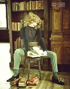 Juju Ivanyuk reads among books.Kolejli ve Soylu,Vogue Turkey, September 2011.Photography: Ellen von Unwerth.
