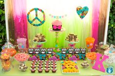 """Peace, Love, and Owls Birthday: Look """"whooo"""" is turning one! Bright funky patterns, tulle, and plenty of owls made for a hoot of a party. Source: Sweets Indeed"""