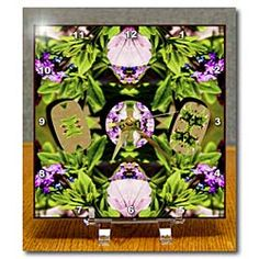 Pink and Purple Flowers cut into shapes and given some depth on green leaves Desk Clock