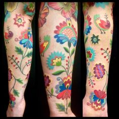 Amanda Chamfreau uses a bold color scheme in this lovely paisley flower and stylised bird tattoo