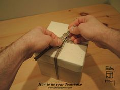How to tie a Tomobako. The tomobako is a traditional Japanese paulownia wood box used to protect and store fine pottery. Hand made by expert craftsmen, learning to tie one takes a bit of practice. Jeff over at Timothy Pottery has made a great step-by-step to show you how!