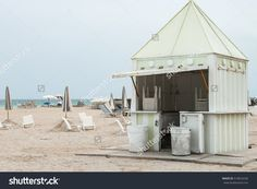 Beach Cabin On South Beach Miami Florida . Beach Scene In Miami On A Cloudy Afternoon With Chairs, Sun Umbrellas And Opened Beach House In Art Deco Style Stock Photo 518624236 : Shutterstock South Beach Miami, Miami Florida, Florida Beaches, Sun Umbrella, Beach Scenes, Umbrellas, Art Deco Fashion, Gazebo, Beach House