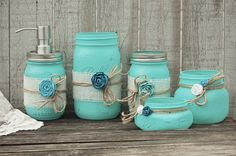 Rustic mason jar bathroom jar set. Hand painted in aqua, wrapped with white burlap, tied with jute and roses, finished with a protective coating. Metal soap dispenser, toothbrush holder, make up brush