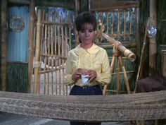 Gilligan is invisible and Mary Ann isn't sure if he is in the hammock or not. Mary Ann And Ginger, Giligans Island, 70s Tv Shows, Tina Louise, Charter Boat, Good Ole, Old Tv, Classic Tv, Beautiful Actresses