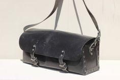 Large French messenger bag, black leather shoulder bag tote SNCF with two buckles and shoulder strap, studded enforcements, 1960s