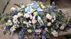 Whites and mixed blues country theme casket spray