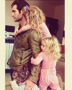 """""""I feel very lucky that sometimes my job looks like this. They like to come watch daddy work and although having my three girls hanging on me doesn't make it easier, it always makes it better. #curlyhairfordays #newjacketdontstandachance #totallyworthit"""" - Alan Powell"""